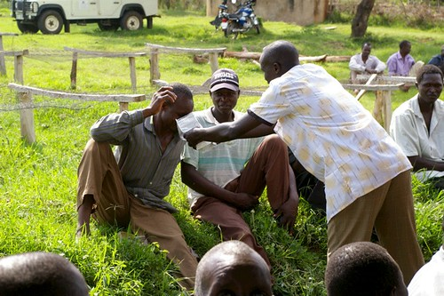 Kenyan coffee farmers smelling our coffee