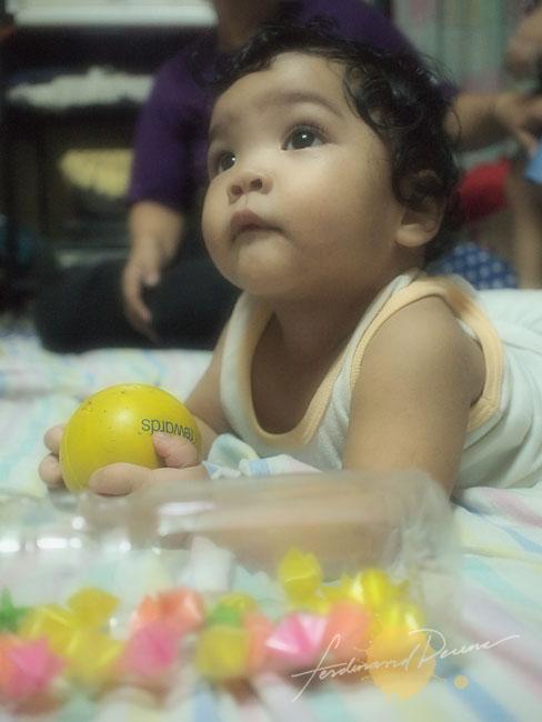 Playing Baby Alexa (Olympus E-P1, ISO 800, 17mm Pancake, f2.6, 1/30sec, Soft Focus Art Filter)