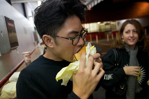 Kris eats a Tommy burger