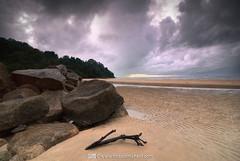 Cloudy Sunrise (Firdaus Mahadi) Tags: sky cloud beach water rock clouds digital sunrise landscape sand scenery gloomy views malaysia awan ultrawide dri batu kuantan pahang pantai