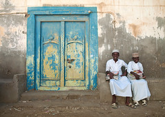 Mirbat boys sitting on a bench with school books, Dhofar, Oman (Eric Lafforgue) Tags: street door school kids books hasselblad arabia porte oman pupils olddoor omn  dhofar arabie mirbat h3d  lafforgue om  omo umman omaan dhufar     omna omanas umn