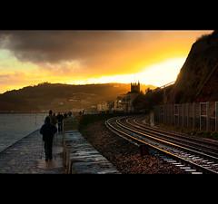 Lead In Light (©Komatoes) Tags: uk light sea stone wall 50mm nikon track waves f14 railway trains line devon lead teignmouth in d40