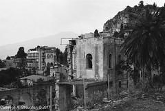 CNV00036s (Cameron A. Straughan) Tags: travel tourism eccentric quirky surreal odd architecture street history angles lines culture 35mm exposures film developing 400 iso real photography traditional photographs fuji stx2 camera processing tamron zoom lens 35 mm manual black white photos classic old school ilford taormina hill mountains sicily mount etna active volcano teatro antico di ancient greco¬roman godfather francis ford coppola italy