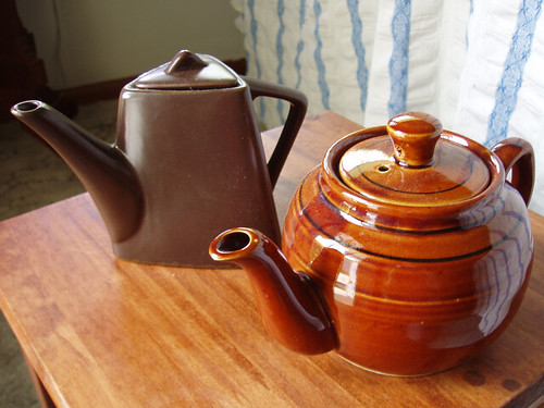two brown teapots