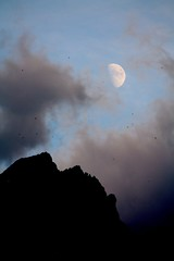 Moonscraping clouds over the Red rock and swallows (Robyn Hooz) Tags: italy canon tirol italia alto moso efs sud adige sesto valpusteria 55250 1000d
