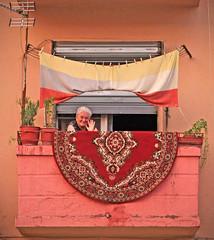 Woman waving from a balcony (allan.macdonald) Tags: street mountains night balkans albania durres tirana kruja tirane shkodra allanmacdonald aileandomhnallach
