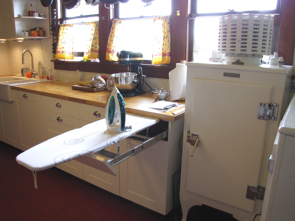 Built-in ironing board in kitchen