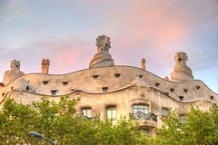 Stone waves against a blushing sky (MarcelGermain) Tags: barcelona pink trees windows roof sunset sky building art lamp leaves stone architecture clouds geotagged evening arquitectura nikon europe european balcony catalonia gaudi catalunya terrat hdr chimneys catalan barcelone modernisme casamil artnoveau lapedrera antonigaud catalogne eixample passeigdegrcia xemeneies d80 marcelgermain