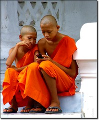 'New Technology' (cisco ) Tags: portrait orange temple cell monk cisco motorola laos luangprabang newtechnology photographia theunforgettablepictures thesuperbmasterpiece photographia giugno2009 elitegalleryaoi