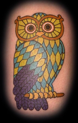 snowflake tattoo. owl tattoo