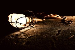 Unplugged (chris johnson.) Tags: stilllife yellow concrete photography photo darkness crack late unplugged olio chrisjohnson hotlights worklamp fincut topazadjust kitgrene 28daysproject khristphoros
