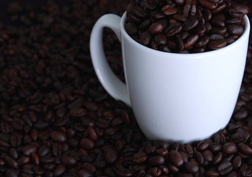 Photo of mug with coffee beans