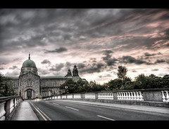 Clouds come floating into my life, no longer to carry rain or usher storm, but to add color to my sunset sky. (edmundlwk) Tags: road bridge ireland sunset galway clouds cathedral hdr muted cokin ndgrad therifles canon450d rebelxsi tokina1116mm edmundlim forthemeantime