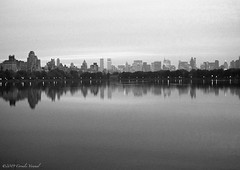 It was a Grainy Dusk (CVerwaal) Tags: blackandwhite skyline analog reflections skyscrapers dusk centralpark manhattan ishootfilm oldschool reservoir minotar kodakgold800 minox35ml