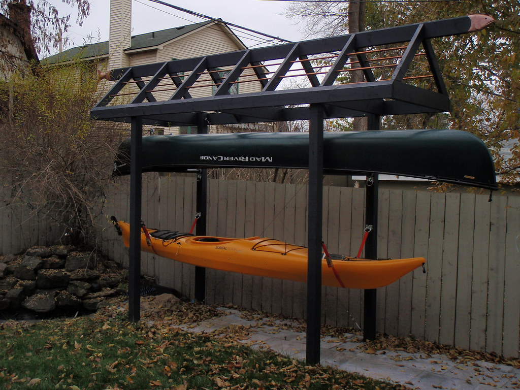 My quirky canoe kayak storage rack my kayaking buddies for Boat storage shed plans