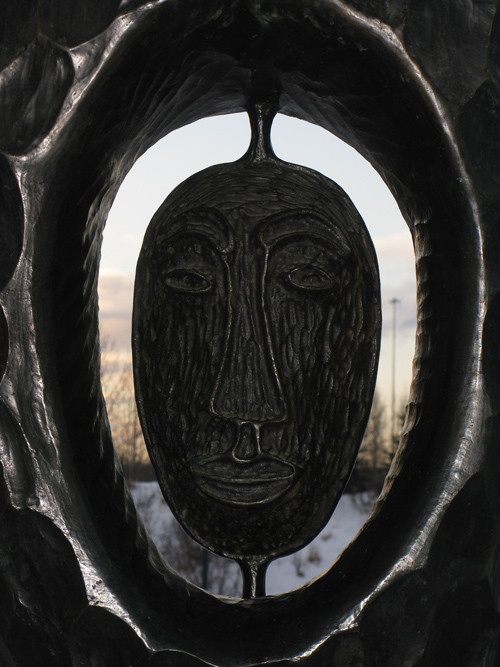 face in sculpture at entrance to the Alaska Native Heritage Center, Anchorage, Alaska