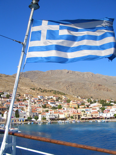 The Greek Flag in front of the Isle of Chalki