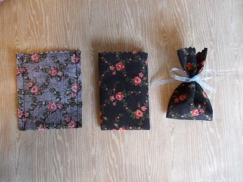 pinking and tying the little gift bags