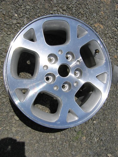 This is an aluminum wheel with a normal finish. Aluminum wheels can have several kinds of finishes including polished, two toned and chrome.