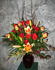 "#06ED $200- 12 Red roses, 6 Konfetti roses, Lilies, dogwood branches, & silk foliage make up this beautiful display of fresh flowers. • <a style=""font-size:0.8em;"" href=""http://www.flickr.com/photos/39372067@N08/3725610202/"" target=""_blank"">View on Flickr</a>"