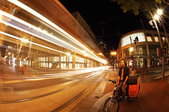 City Transport (Ian Sane) Tags: street city light max bike night oregon train canon portland lens ian eos star long exposure downtown place shot mark cab transport fisheye ii 5d pioneer sane bikecab 503bikecab dwcffnight