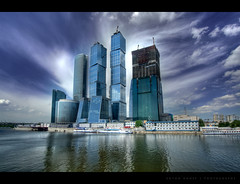 MIBC Moscow City (anton khoff) Tags: city blue sky urban reflection building water architecture clouds canon construction skyscrapers moscow wide wideangle center business international 1022mm hdr moscowcity canon1022mm mibc 1000d antonkhoff