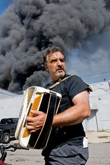 Fire Entertainment (SNWEB.ORG Photography, LLC.) Tags: people music cloud male guy fire person comedy random smoke detroit explosion august accordion event emergency 2009 plume blacksmoke detroitmichigan accordionplayer cityofdetroit detroitmi smokecloud august09 august2009 diversifiedchemical deversifiedchemicaltechnologies