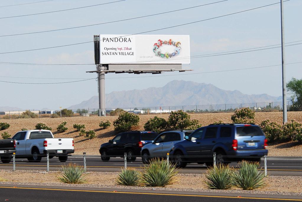 Pandora Grand Opening Sept. 25 at Santan Village - Santan Freeway Loop 202 billboard