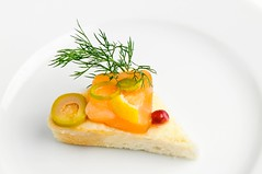 canape with smoked salmon (starush) Tags: food white closeup dill bread one md triangle dish toast details small salmon plate sandwich slice snack appetizer banquet chisinau greenolive refreshment selectivefocus canape smokedfish singleobject republicofmoldova pomegranateseed