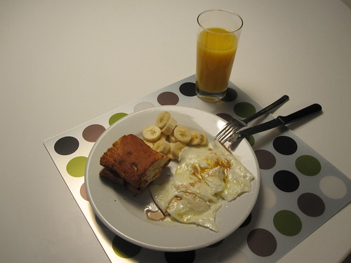 Eggs, baguette and bananas, drizzled with maple syrup. OJ.