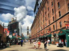 Take me out to a Ballgame! (` Toshio ') Tags: sky woman man building men clock girl architecture clouds america fan women downtown baseball stadium crowd maryland baltimore billboard ballgame hotdogs fans hdr orioles hon scoreboard camdenyards baseballstadium toshio bromoseltzertower eutawstreet bawlmer highdynamicresolution heritage2011