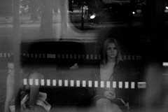 Through the window of a night tram (Rickard Nilsson) Tags: city morning blackandwhite bw reflection sexy girl station lady youth night canon gteborg eos 350d sadness 50mm aftermath downtown sad weekend gothenburg hangover teenager unhappy nilsson sprvagn throughthewindow rickard domkyrkan tramstation flicka kur gothenburgcity hllplats sadnes viewonblack nighttram throughthewindowofanighttram
