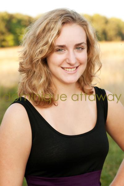 girl senior close up in golden grass field