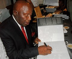 Alf Kumalo signs the first book