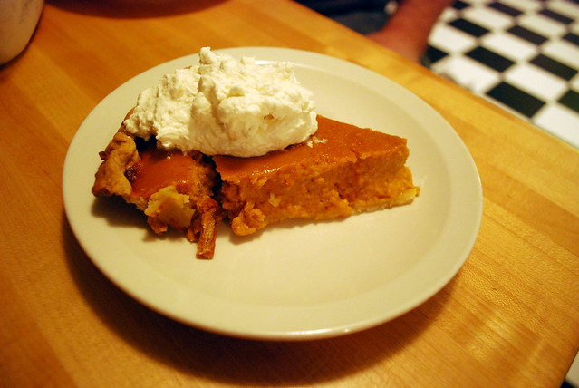 Homemade pumpkin pie with homemade whipped cream