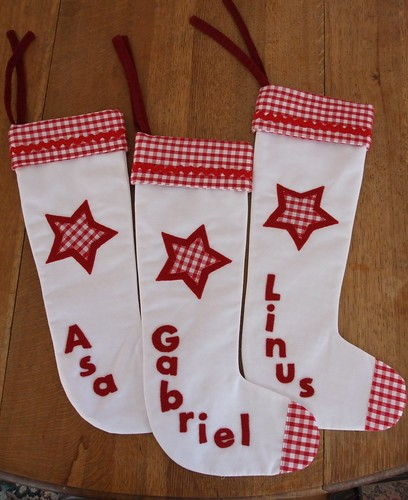 3 red and white Christmas stockings