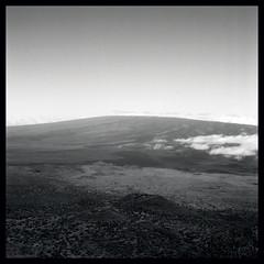 Untitled (dreamerofmeaning) Tags: road light sky bw 120 weather clouds mediumformat dark square volcano hawaii soil bigisland maunakea maunaloa vocano