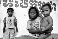 """kids by wall - border town, Cambodia (Sailing """"Footprints: Real to Reel"""" (Ronn ashore)) Tags: poverty street people blackandwhite slr film kids youth portraits children cambodia faces bordertown poor young nikkor24mmf28ais nikonfm2n 100tmax 200920july0034nikonfm2n24mmf28ais100tmaxcambodia"""