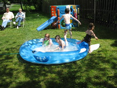 Cousins playing in the pool