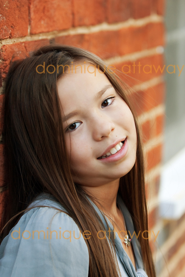 47 little girl portrait brick wall
