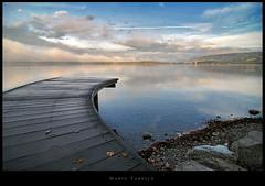 Il risveglio del lago - ottobre 2009 (Mario Tarello) Tags: morning water rock fog boat mood stones earlymorning tokina1224 nebbia riflessi mattina ladscape viverone ninfee lagodiviverone tarello mariotarello risvegliodellago mariotarllo