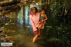 Woman and child in a swamp (Asian Images) Tags: poverty travel girls portrait woman tourism girl portraits children asian temple pond women asia cambodia southeastasia cambodian cambodians child buddhist traditional poor buddhism angkorwat backpacking swamp siemreap angkor indianajones wats bayon khmerrouge