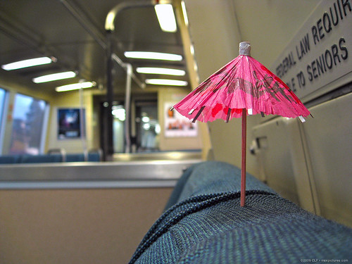 Pink umbrella on BART, see a larger pic at calixtonpix on Flickr