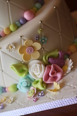 Whimsical flowers (Andrea's SweetCakes) Tags: flowers bird leaves cake daisies buttons butterflies baptism fabricroses silverdragees diamondembossed ribbinroses