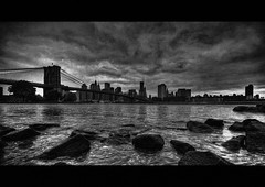 (hans jesus wurst) Tags: nyc newyorkcity sky usa water clouds photoshop blackwhite stones curves border brooklynbridge manhattanskyline vignette hdri lucisart blackandwhiteconversion photomatix tonemapping 3exphdr highdynamicrangeimage canoneos400d sigma1020mm1456dchsm hansjesuswurst moritzhaase