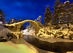 The Packhorse Bridge - Carrbridge (freeskiing) Tags: longexposure bridge blue trees winter snow ice water clouds scotland frozen highlands december arch explore twlight carrbridge cairngormsnationalpark sigma1020mm dramaticcloud highlandsofscotland riverdulnain benthorburn