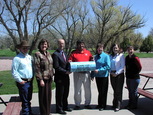 A pipe was signed by those instrumental to the water project.  Administrator Adelstein is third from the left and State Director Moul is third from the right.