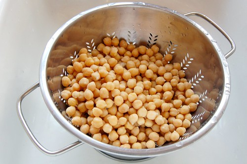 Chickpeas draining in colander in sink by Eve Fox, Garden of Eating blog copyright 2011