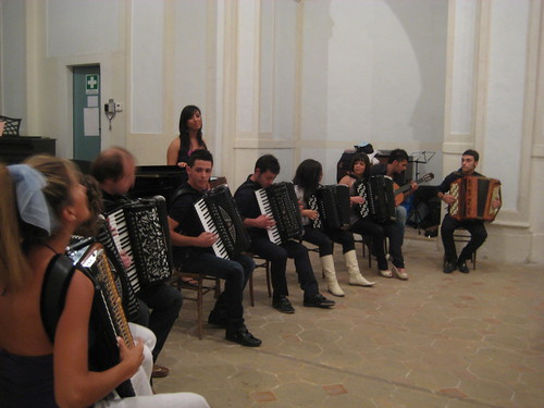 accordion octet, with guitarist and singer