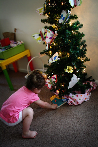 "She decided to put some ""presents"" under the tree"